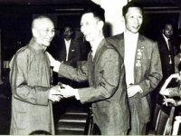 Ip Man (left), Chu Chong Mun of the Chi Sim Weng (center), Ip Bo Ching (right)