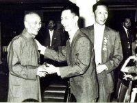 Ip Man (left), Chu Chong Mun of the Chi Sim Weng (center), Ip Bo Ching (right)
